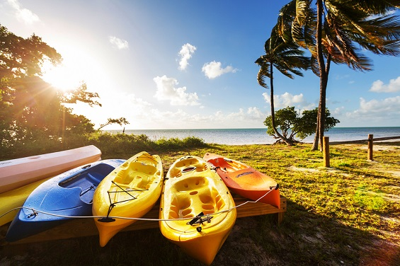 About Us = Kayaks on a beach