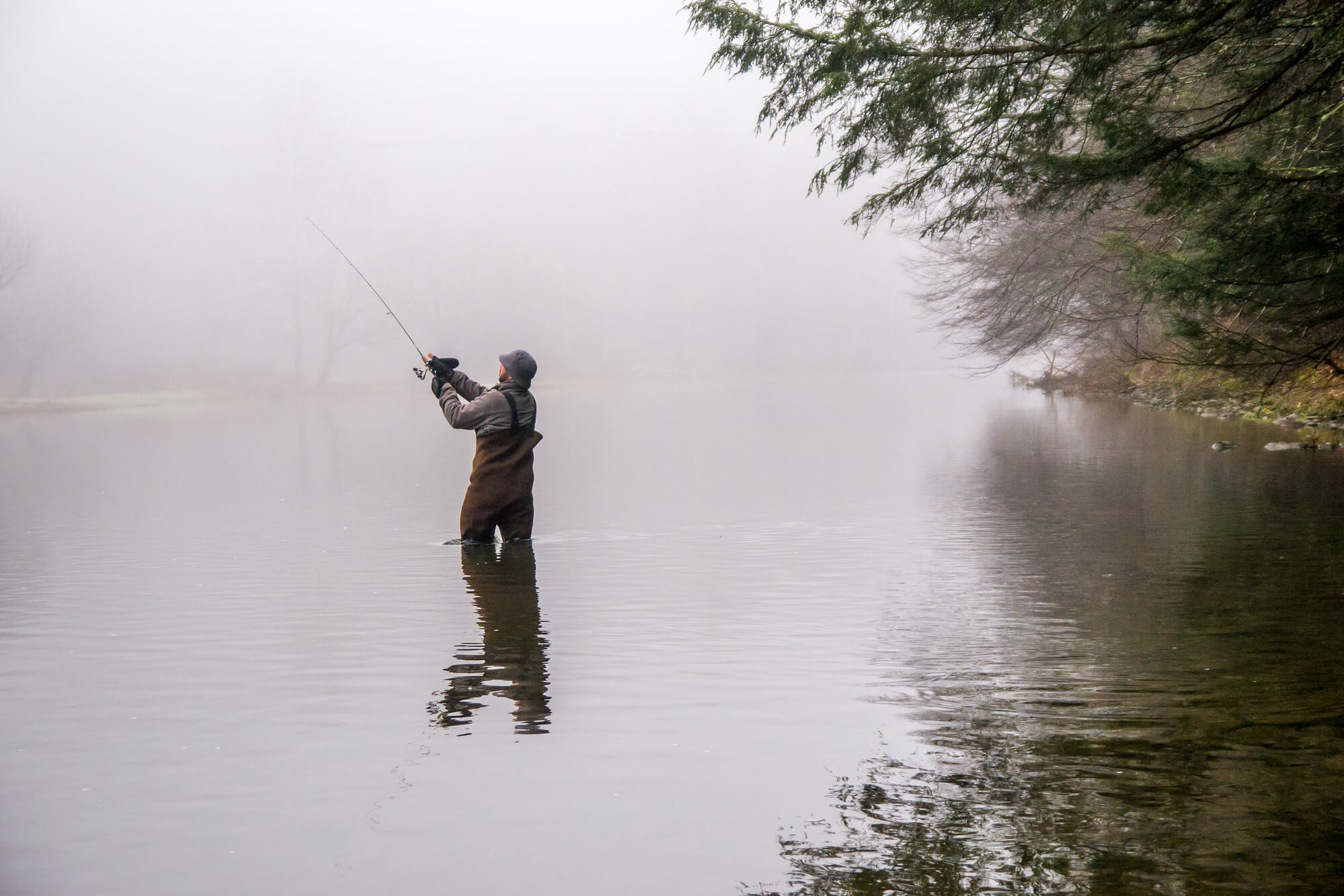 Man casting on a river