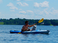 Man with dog on kayak