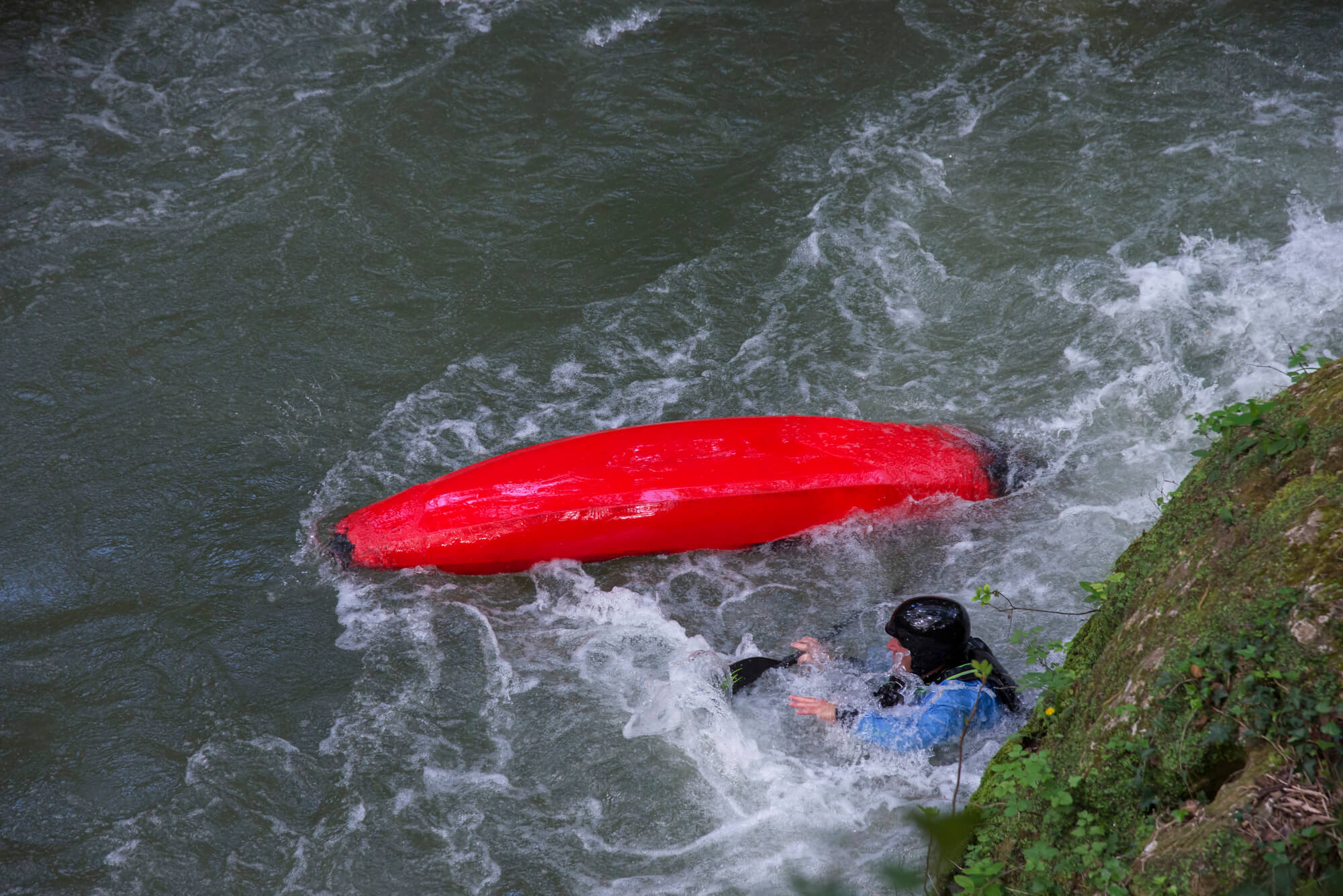 Kayak Flipped Over With Man