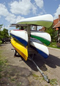 Kayaks canoes loaded on special transport trailer