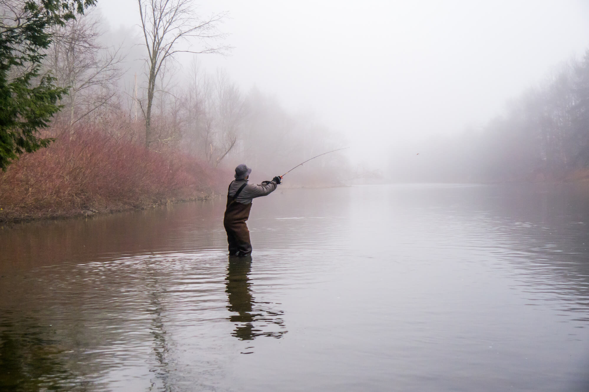 Man fishing with waders on