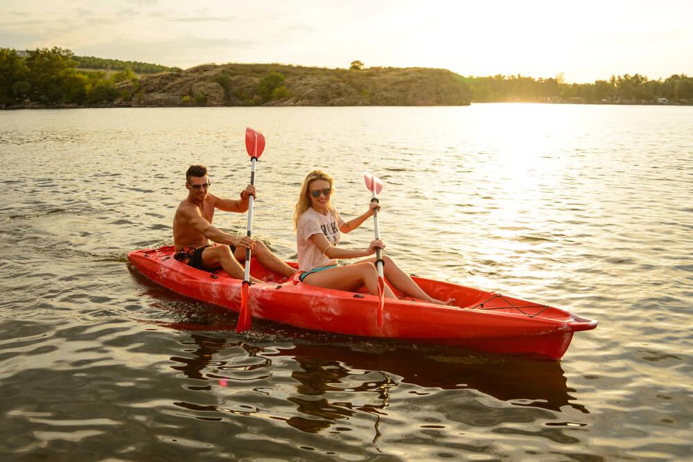 Couple on Tandem sit on top kayak